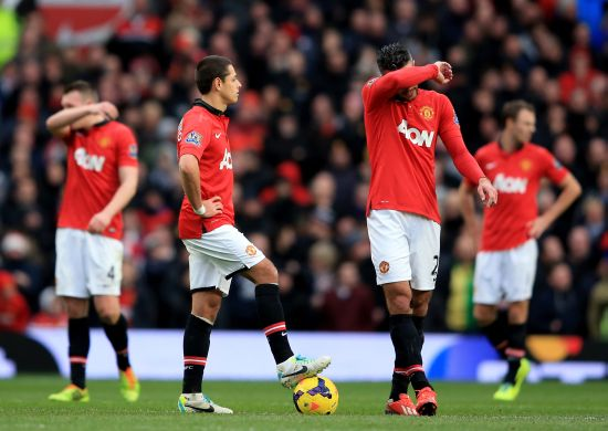 Dejected Manchester United players look on after conceding a goal