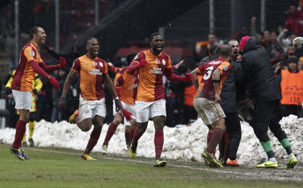 Wesley Sneijder of Galatasaray (2nd R) celebrates his goal against Juventus during their Champions League soccer match in Istanbul