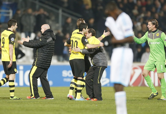 Borussia Dortmund players react after winning their Champions League match