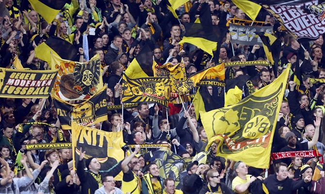Borussia Dortmund supporters react after their team won their Champions League match
