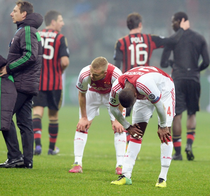 Ajax Amsterdam players dejected at the end of the UEFA Champions League Group H match against AC Milan
