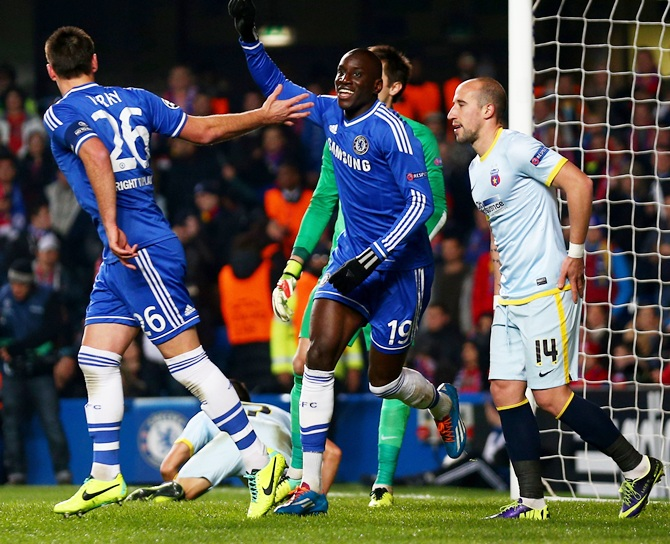 Demba Ba of Chelsea celebrates with teammate John Terry