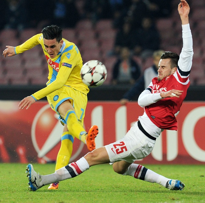 Jose Callejon of Napoli and Carl Jenkinson of Arsenal in action