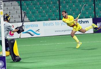 Ramandeep Singh scores India's opening goal against Argentina