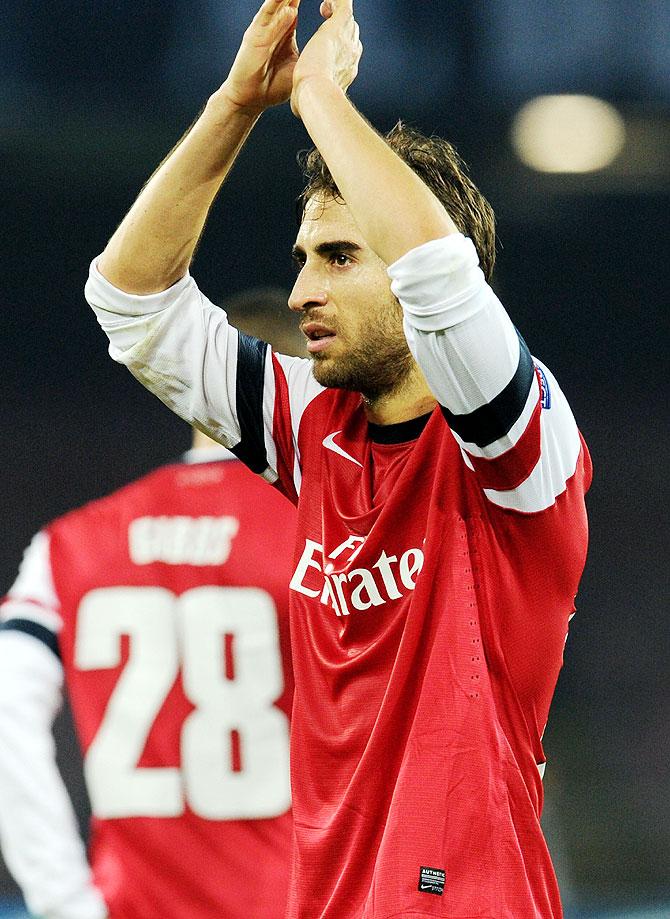 Mathieu Flamini of Arsenal celebrates after the UEFA Champions League Group F match against Napoli