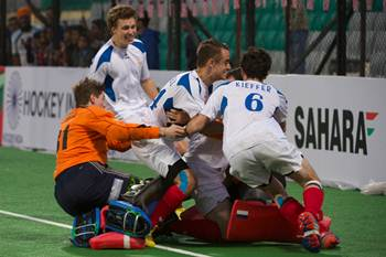 The French players celebrate after winning the penalty shoot-out