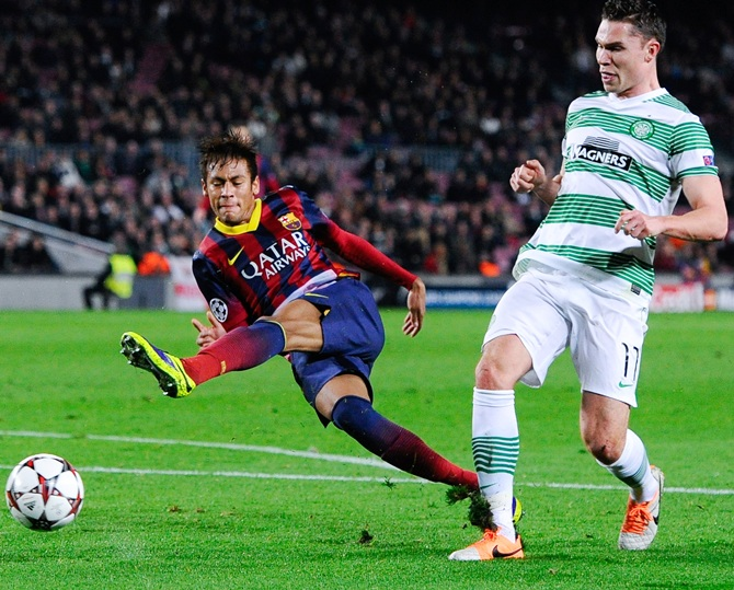 Neymar of FC Barcelona shoots towards goal under a challenge by Derk Boerrigter of Celtic