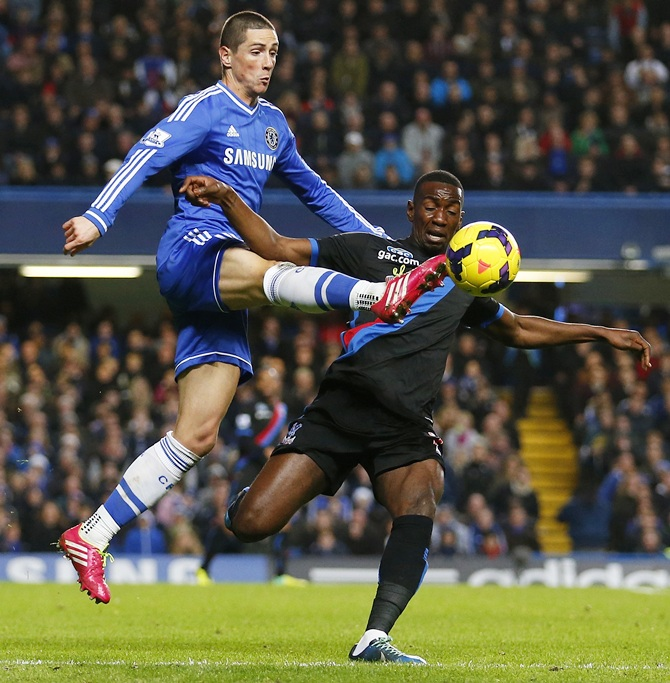 Fernando Torres of Chelsea beats Yannick Bolasie of Crystal Palace to the ball