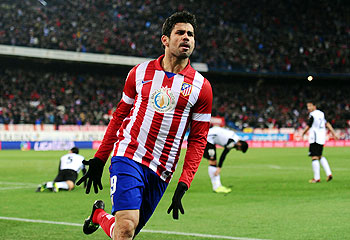 Diego Costa of Club of Atletico Madrid celebrates after scoring agianst Valencia during their La Liga match at Vicente Calderon Stadium in Madrid on Sunday