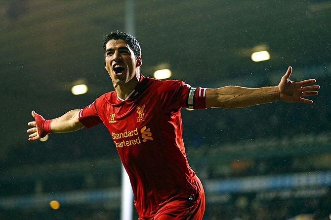 Liverpool's Luis Suarez celebrates scoring their fourth goal agianst Tottenham Hotspur during their English Premier League match at White Hart Lane in London on Sunday