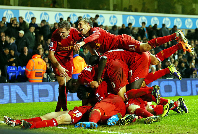 Jon Flanagan of Liverpool is mobbed by his teammates after scoring against Tottenham Hotspur on Sunday