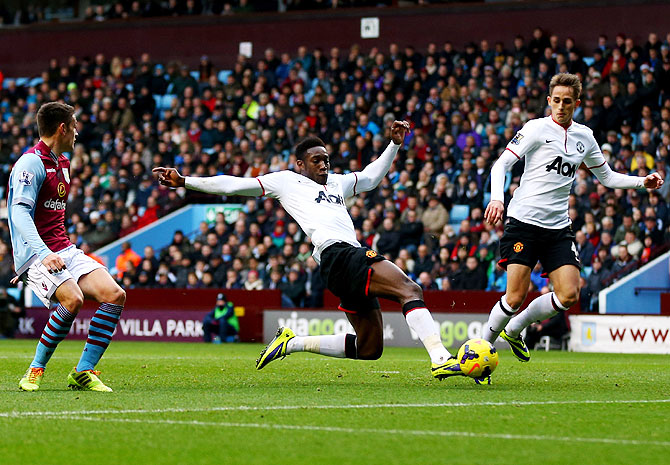 Danny Welbeck of Manchester United (centre) scores their second goal during the Barclays Premier League match against Aston Villa at Villa Park in Birmingham on Sunday