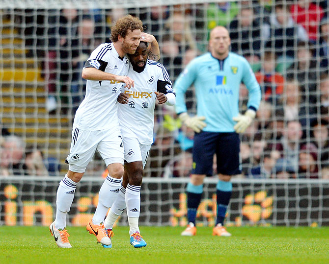 Nathan Dyer of Swansea is congratulated by teammate Jose Canas after he scored against Norwich City at Carrow Road in Norwich on Sunday