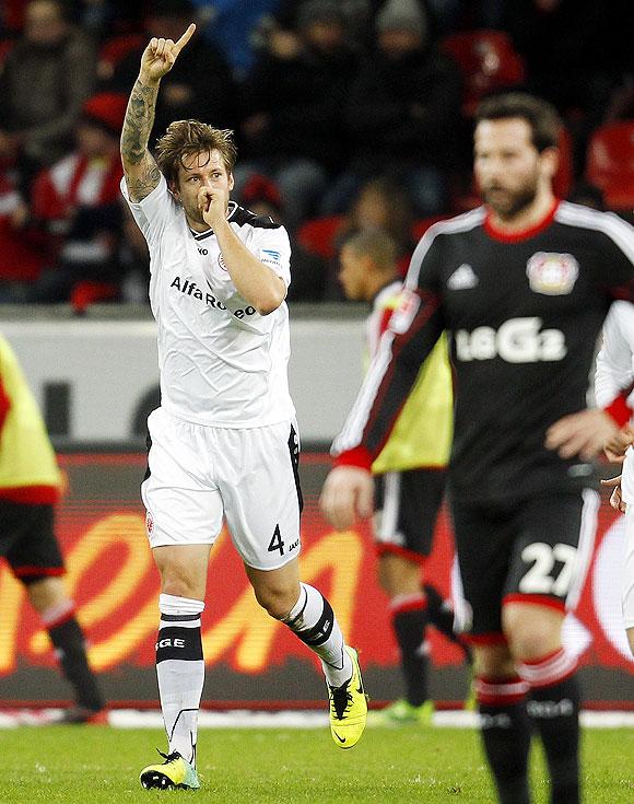 Eintracht Frankfurt's Marco Russ celebrates a goal against Bayer Leverkusen