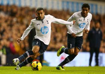 Aaron Lennon and Paulinho of Tottenham Hotspur on the ball during the Barclays Premier League match against Liverpool at White Hart Lane