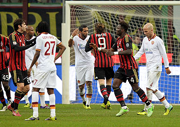 AC Milan's Sulley Muntari (2nd from right) celebrates scoring the second goal against AS Roma during during their Serie A match on Monday
