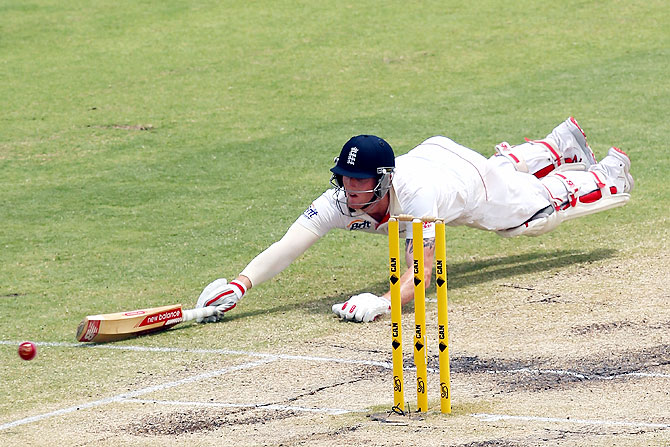 Ben Stokes of England dives to avoid being run out