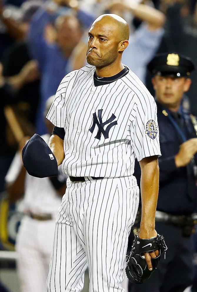 Mariano Rivera of the New York Yankees reacts to the crowd after leaving the game against the Tampa Bay Rays in the ninth inning during their game on September 26