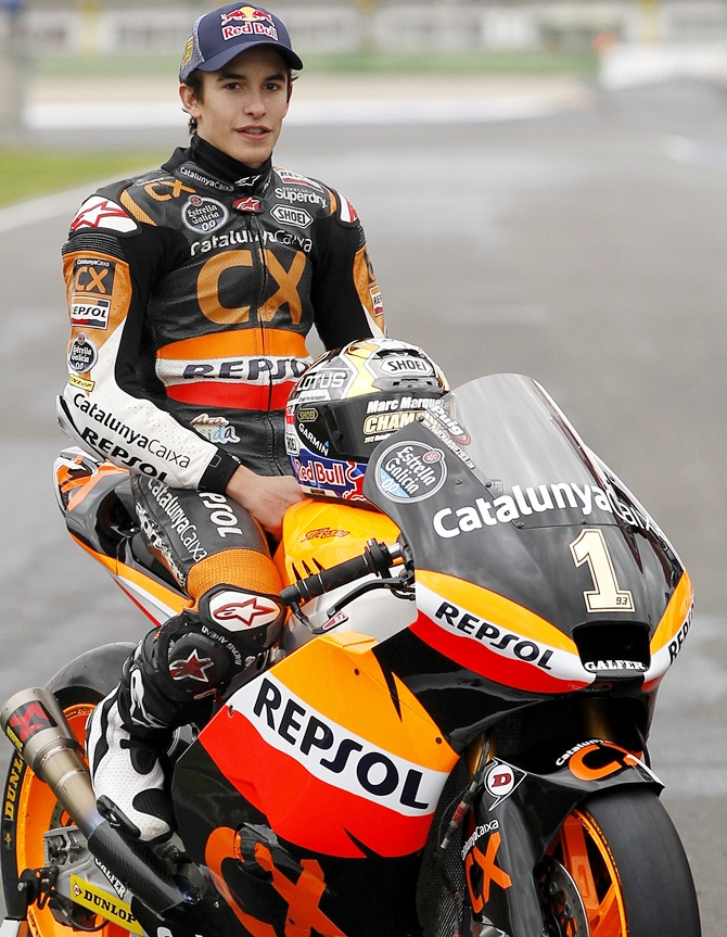 Marc Marquez poses with his motorbike