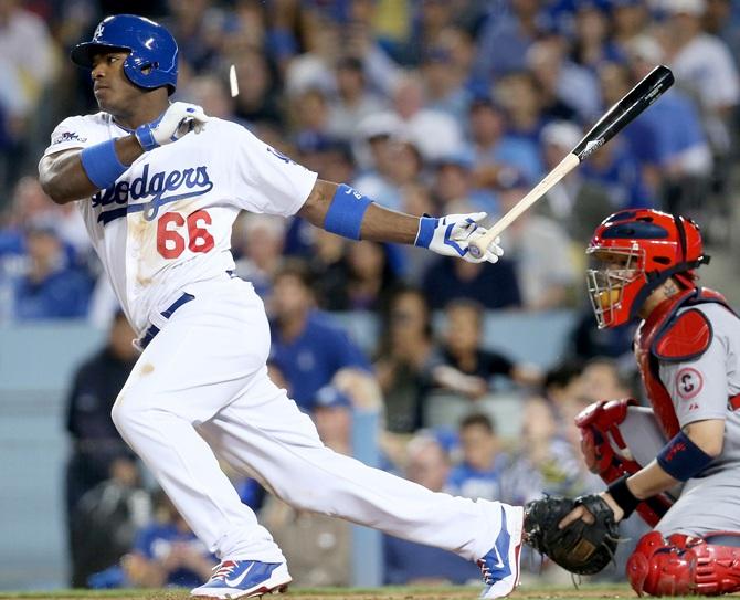 Yasiel Puig of the Los Angeles Dodgers hits a broken bat single