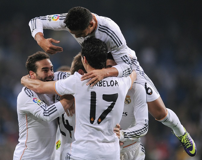Carlos Casemiro (above) of Real Madrid celebrates with Daniel Carvajal (left) and Alvaro Arbeloa after Real scored their first goal