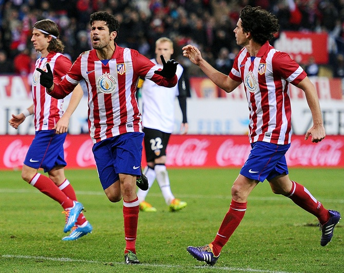 Diego Costa (left) of Club Atletico de Madrid celebrates with Tiago Mendez