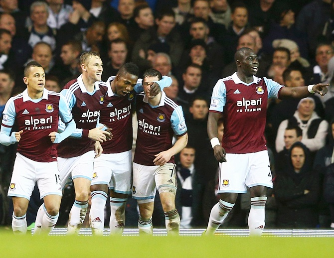 Matthew Jarvis of West Ham United (second right) celebrates with teammates as he scores their first goal