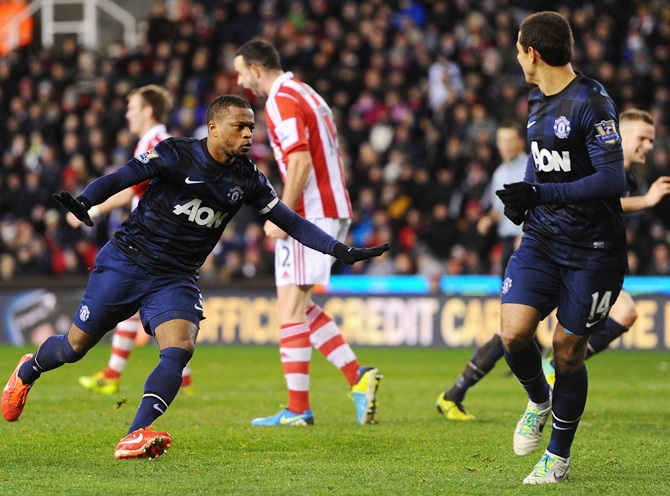 Patrice Evra of Manchester United celebrates scoring his team's second goal