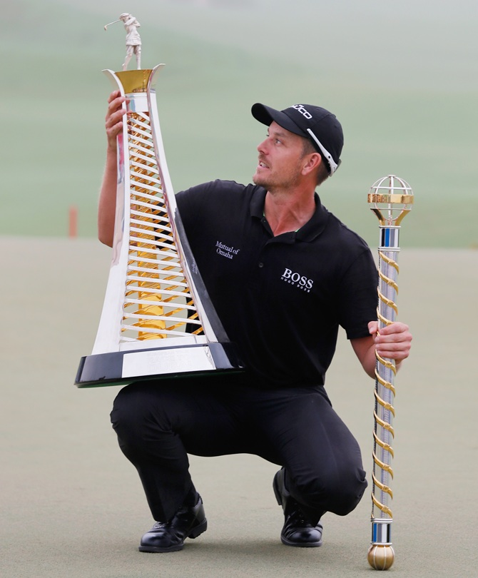Henrik Stenson of Sweden poses with the Race To Dubai trophy