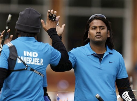 India's Jayanda Talukdar, right, high-fives teammate Rahul Banerjee