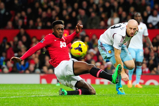 Danny Welbeck of Manchester United competes with James Collins of West Ham United