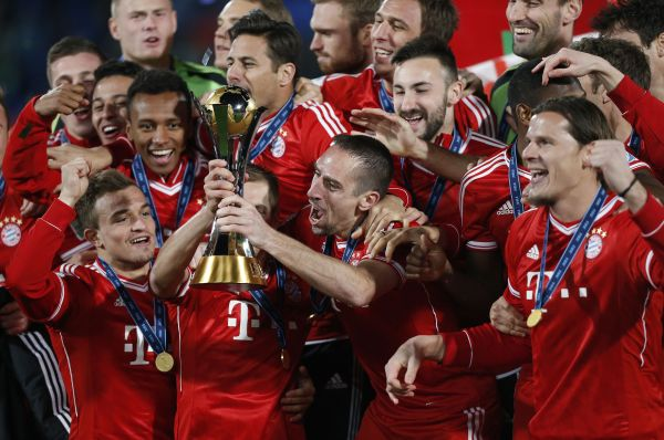 Germany's Bayern Munich Franck Ribery (2nd R) and Philipp Lahm hold the trophy as they celebrate with their team mates after winning their 2013 FIFA Club World Cup final soccer match against Morocco's Raja Casablanca at Marrakech stadium