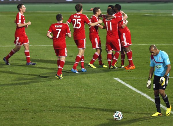 Dante of Germany's Bayern Munich is surrounded by his team mates as they celebrate his goal against Morocco's Raja Casablanca