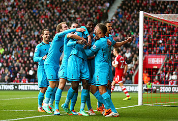Emmanuel Adebayor (centre) of Spurs celebrates with teammates after scoring his team's third goal against Southampton at St Mary's Stadium in Southampton on Sunday