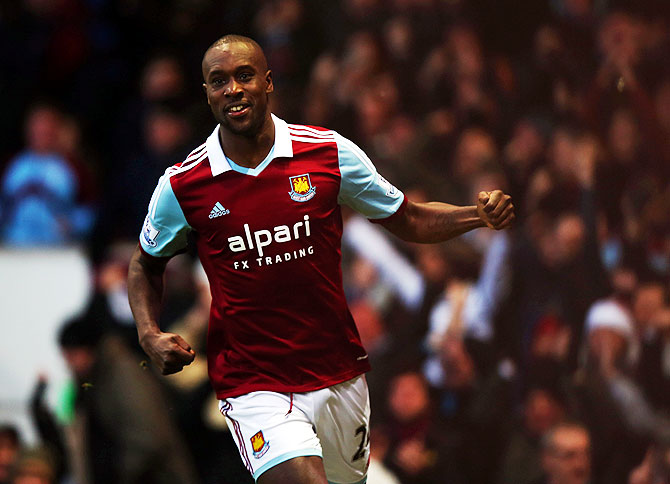 Carlton Cole of West Ham United celebrates as he scores their first goal against Manchester United