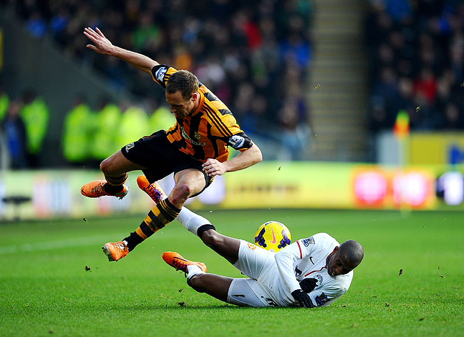 Ashley Young of Manchester United battles for the ball with David Meyler of Hull City