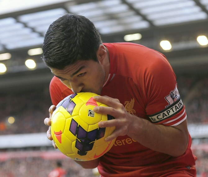 Liverpool's Luis Suarez reacts