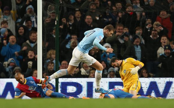 Edin Dzeko of Manchester City celebrates scoring the opening goal during the Barclays Premier League match between Manchester City and Crystal Palace at the Etihad Stadium