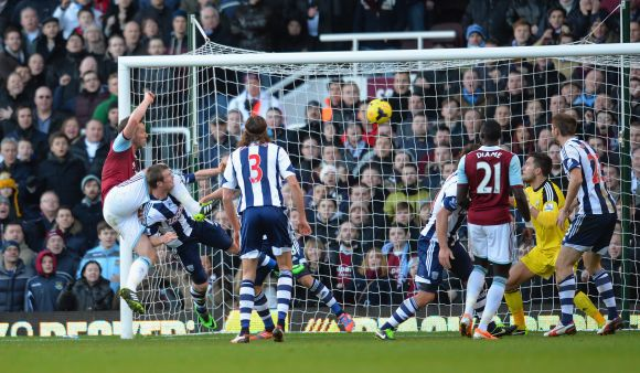 Kevin Nolan of West Ham scores their third goal during the Barclays Premier League match between West Ham United and West Bromwich Albion