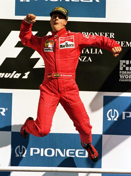 Ferrari driver Michael Schumacher jumps for joy on the podium after winning a stunning race after the Italian GP, held in Monza, Italy, on September 8, 1996