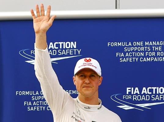 Third-placed Michael Schumacher of Mercedes celebrates in parc ferme following qualifying for the Malaysian GP on March 24, 2012