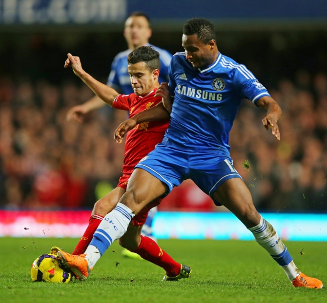 Philippe Coutinho of Liverpool and John Obi Mikel of Chelsea compete for the ball