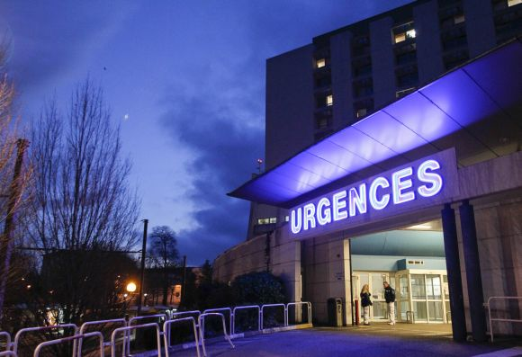Members of the staff are seen outside the emergency services at the CHU Nord hospital in Grenoble
