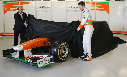 Sahara Force India Formula 1 driver Paul Di Resta of Great Britain and deputy team principal Robert Fearnley unveil the team's new car