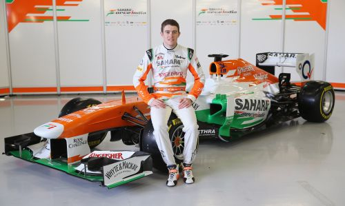 Sahara Force India Formula 1 driver Paul Di Resta of Great Britain with the team's new car for the 2013 Formula 1 season