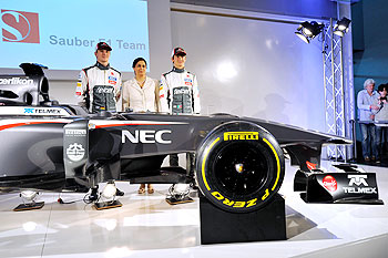 Sauber F1 driver Nico Hulkenberg of Germany, Sauber Team Principal Monisha Kaltenborn, and Sauber F1 driver Esteban Gutierrez of Mexico unveil the Sauber C32-Ferrari new car for the 2013 F1 season