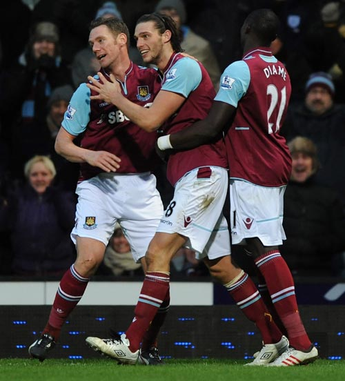 Andy Carroll (C) of West Ham United celebrates scoring the first and only goal of the game with Kevin Nolan (L) and Mohamed Diame during the Barclays Premier League match