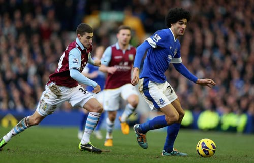 Marouane Fellaini of Everton moves away from Matthew Lowton of Aston Villa during the Barclays Premier League match
