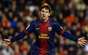 Barcelona'S Lionel Messi celebrates after scoring against Valencia on Sunday