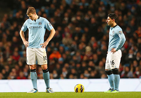 Manchester City's Edin Dzeko and Sergio Aguero (right) wear a dejected look after concedin a second goal against Liverpool on Sunday